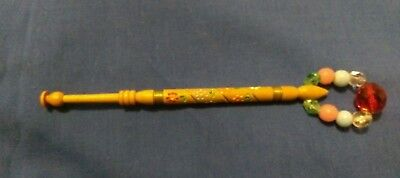 1 wooden lace bobbin with beautifully painted flowers along the shaft and wire