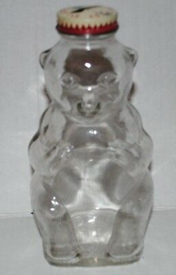Vintage Snow Crest Glass bear bank bottle