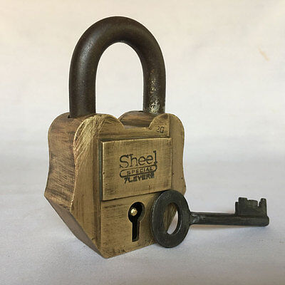 012 An old or antique solid brass padlock lock with key rich patina