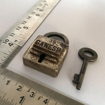 002. An old or antique solid brass padlock lock with key rich patina GANESH