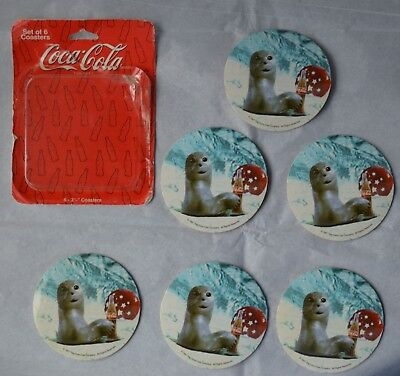 1997(6) Coca-Cola coasters seal w/coke & ball in snow/front cork back (free ship
