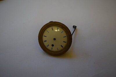 antique pocket watch made into a small clock movement