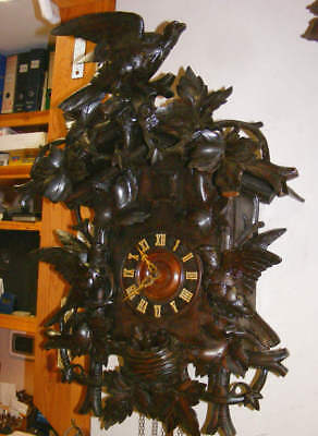old very big Black Forest cuckoo clock, birds with a nest