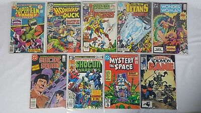 Marvel DC Mix Comic Book Lot Wonder Woman Avengers Howard the Duck 9 Books Total