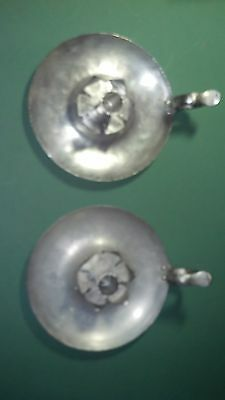 A Pair Of Vintage Hand Wrought Alminum Fingerhold Candlestick Holders