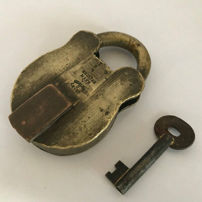 An old or antique solid brass padlock lock with key rich patina brass shackle