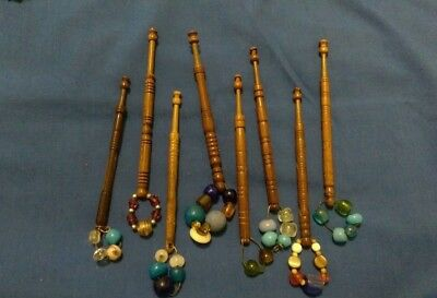 8 antique wooden lace bobbins, with spangles.