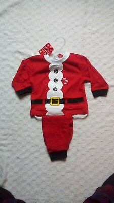 Santa Pyjamas 6-9 months. Red Long Sleeve Cuffed Bottom and Sleeves.