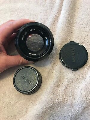 Nikon Nikkor 50 mm 1:1.4  no. 2816289 lens with covers