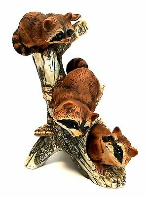 Raccoons Playing in a Hollow Log Figurine Three Babies Porcelain 8 x 6 inches
