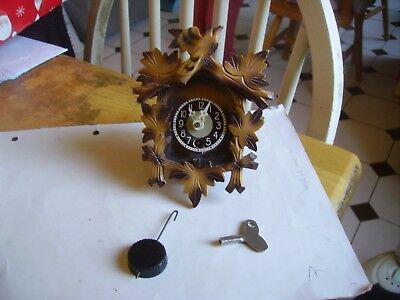 Lovely vintage cuckoo style time-piece/clock with pendulum & key 1980s.