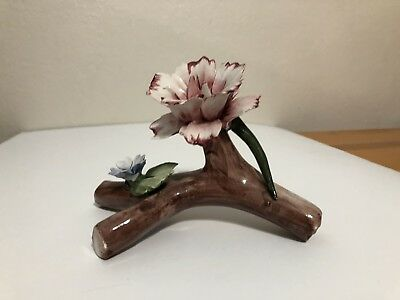 Vintage capodimonte flowers on a log made in Italy
