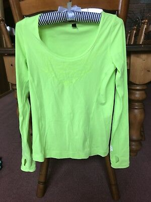 LORNA JANE x3 plus RUSSELL x1 tops. Both New and worn. Sizes S. 8 - 10