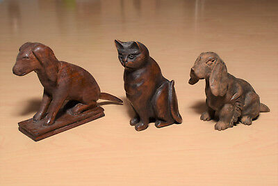 2 Hand Carved Wooden Dogs and 1 Cat