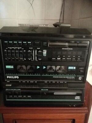 Philips Music System in black with speakers and remote control.