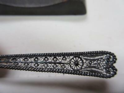 VINTAGE STERLING SILVER  SPOON WITH PIERCED ORNATE HANDLE and display holder