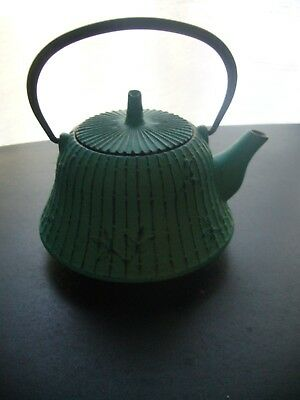 Cast iron metal Oriental Teapot with strainer