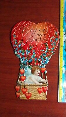 Antique embossed valentine - 1910 cherub in balloon with heart shaped ballasts
