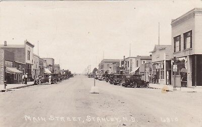 early 1900s RPPC Stanley North Dakota Main Street, Dirt Road, Old Signs Cars  ND