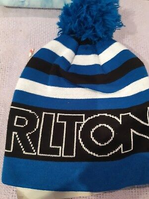 carlton dry beanie with bobble ontop