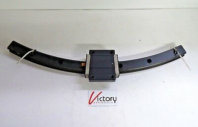 "Used THK Round Linear Bearing | THK Y6E118-1A | Curved 24"" Black Guide Rail"