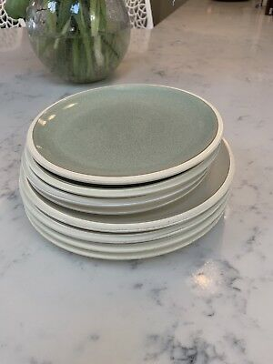 Four Denby energy cream dinner plates and four green smaller plates