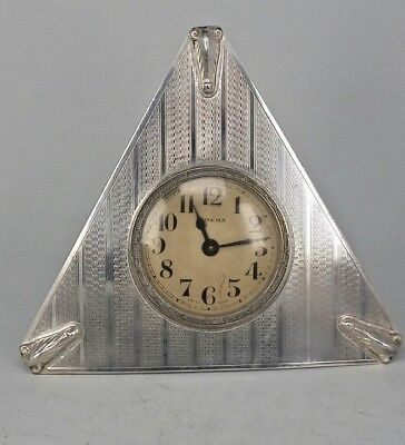 1932 Stylish Art deco triangular silver clock with guiloched silver pattern