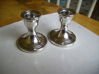 Two pairs of collectible small hallmarked candlesticks dating 1967.