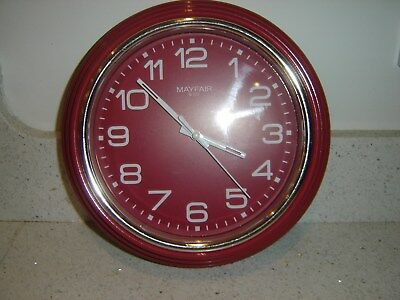 Wall clock Mayfair & Co. white face, red surround, excellent condition.