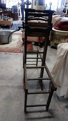 Vintage clothes wringer with wooden bench