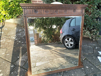 Wood framed antique over mantel mirror
