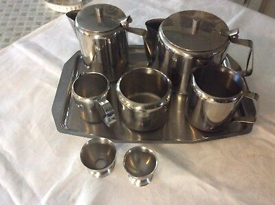 1960s STAINLESS STEEL EIGHT PIECE TEA/COFFE SET WITH TWO EGG CUPS AND TRAY