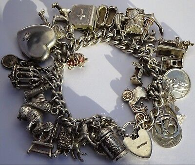 Wonderful vintage solid silver charm bracelet & 30 charms,rare,open,move. 110.7g