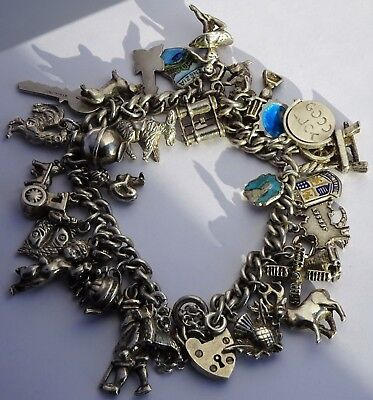 Gorgeous vintage solid sterling silver charm bracelet & 29 wonderful charms