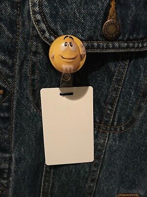 m&m's name badge holder yellow