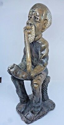 Hand carved stone statue Tribal African design with pipe Old man Vintage