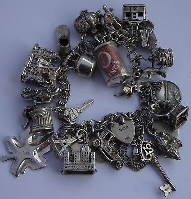 Lovely vintage solid sterling silver charm bracelet & 29 charms,rare,open,move