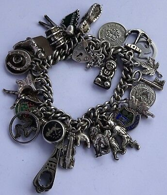 Fabulous vintage solid sterling silver charm bracelet & 30 lovely silver charms