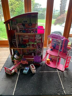 Dollhouses with furniture and assorted toys