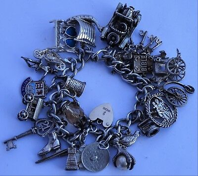 Wonderful vintage solid silver charm bracelet & 24 charms, rare, open, move