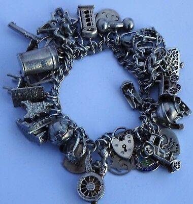Gorgeous vintage solid silver charm bracelet & 34 charms, rare, open, move