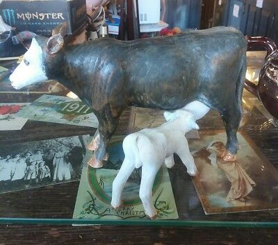 Folk art hand carved wooden cow and calf,  signed and dated
