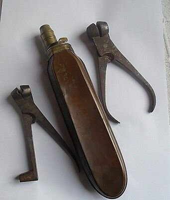A Unusual Shaped C19 Powder Flask And 2 Musket Ball Moulds