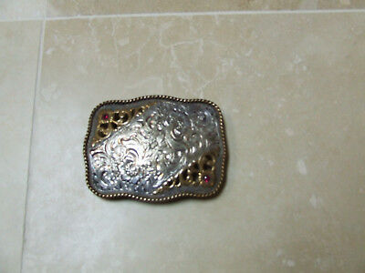 Vintage western rodeo belt buckle with 2 ruby colored stones ( Crumrine MFG Reno