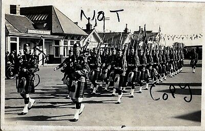 soldier group Black Watch Pipers & men marching through Ballater Scotland