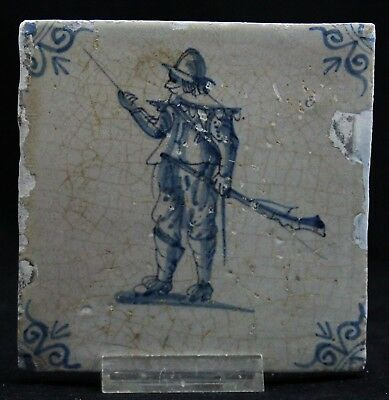 antique 17th C. Delft blue Tile, marching Soldier with musket and sword, ca.1650
