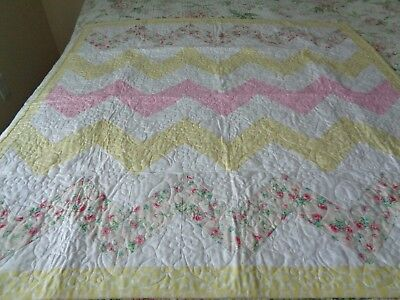 pink and yellow baby quilt