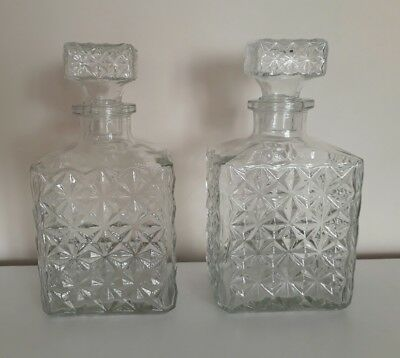 """A PAIR OF CUT GLASS DECANTERS. 8"""" (20cm) WHISKEY, BRANDY, RUM ETC.."""