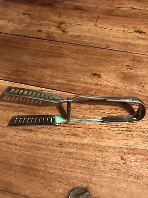 Vintage Pair Of Silver Plated Tongs
