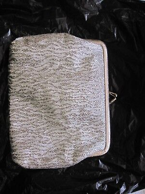 Small silver evening bag with toggle clasp unbranded